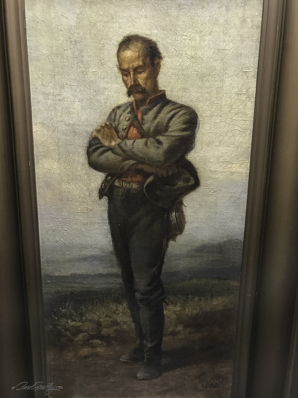 """""""Appomattox"""" by John Elder, an 1880 oil painting signed and dated by the artist. It is a compelling portrait of a Confederate soldier following the surrender of General Lee. The soldier is portrayed with arms crossed and head slightly bowed, with downcast eyes - typifying the blend of defiance and sorrow felt after the surrender."""