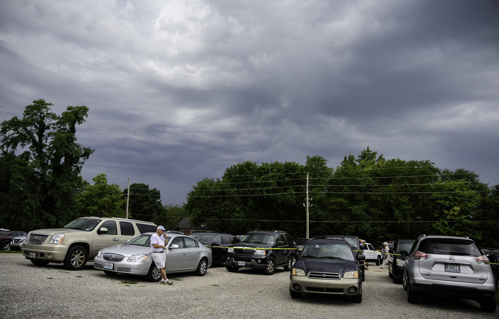 About an hour and a half before the eclipse was to start, the storm moved in! Many people retreated to their cars (we did). It rained hard for about ten minutes and then sprinkled for a bit after that.