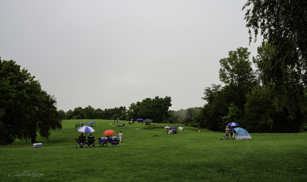 But, as you know, there are die-hards in every crowd! These folks toughed it out. I returned just as the rain let up to document their commitment. We could see a bit of blue to the west and were ever so hopeful that we would have sun breaking through the clouds in time to fully see the eclipse.