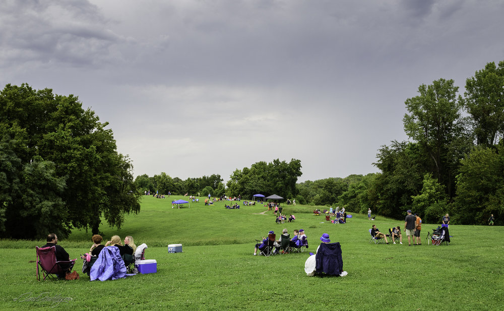 People started returning as soon as the rain let up. It was still very overcast and the field was very wet for those who had chosen to bring blankets to sit on. Nothing seemed to deter the excitement.