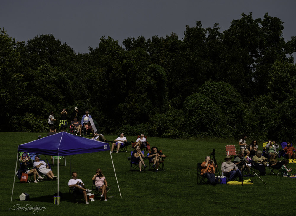 Minutes before totality it got much cooler and the whole place became darker. But, unlike a sunset which has a side reference point of light and color from light to dark, this darkening was much, much faster and it was evenly distributed.