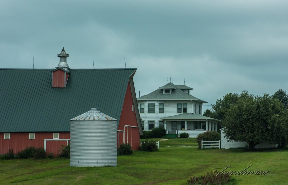 Silos and red barns next to old white houses.  I just never tired of them.
