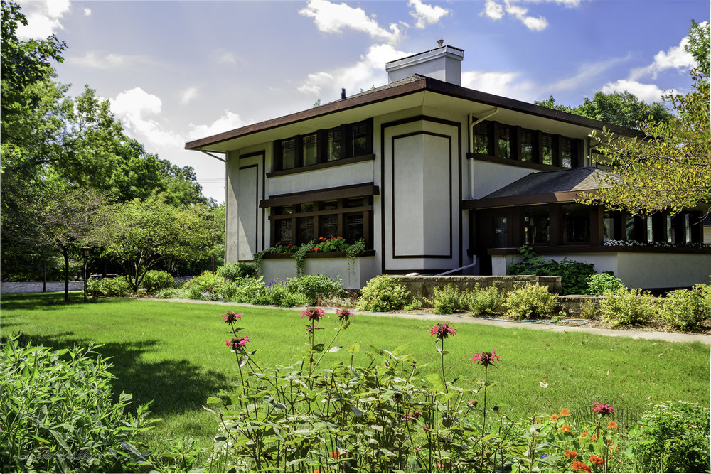 "This is known as the Stockman House.  It was designed by Frank Lloyd Wright based on his open floor plan described in his 1907 Ladies Home Journal article ""A Fireproof House for $5,000.  The design was to become the Prairie School approach to housing needs of America's middle class.  The home is now owned by the River City Society for Historic Research and is open to the general public as a house museum.  It was not open when we visited the site."