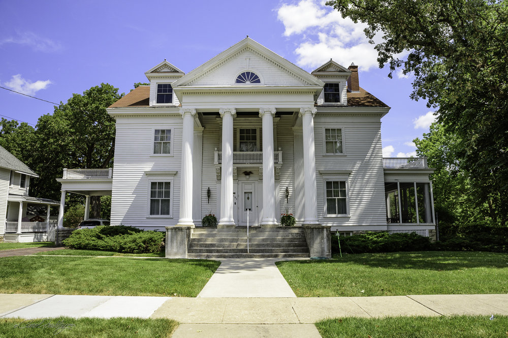 This impressive home is known as 'Stonyacre'.  It is a Neo-Classical Revival house built in 1901.  It might be of interest to know that right behind many of these homes ran a river that periodically flooded the area, even though most of them were built on a bluff above the river.