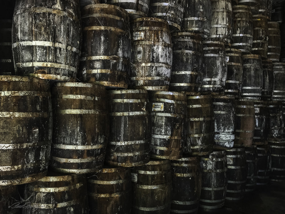 The white oak barrels are re-used. These are waiting to be cleaned up and repaired. When the barrel is no longer usable it is made into wood chips for barbecuing!