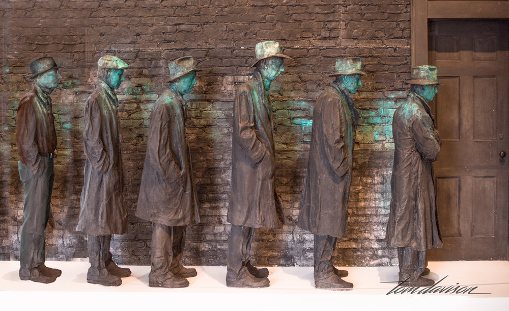 Tom created an image that adds him to the 5 men in line.  Nicely done considering he did not have an old trench coat.  There is one other subtle difference that I noticed.  Tom is at the end of the line and it is his first time there.  He is not quite as beaten down and discouraged as the other men.  He is the optimist in line that he is every day.  His shoulders are straight and his head held high.