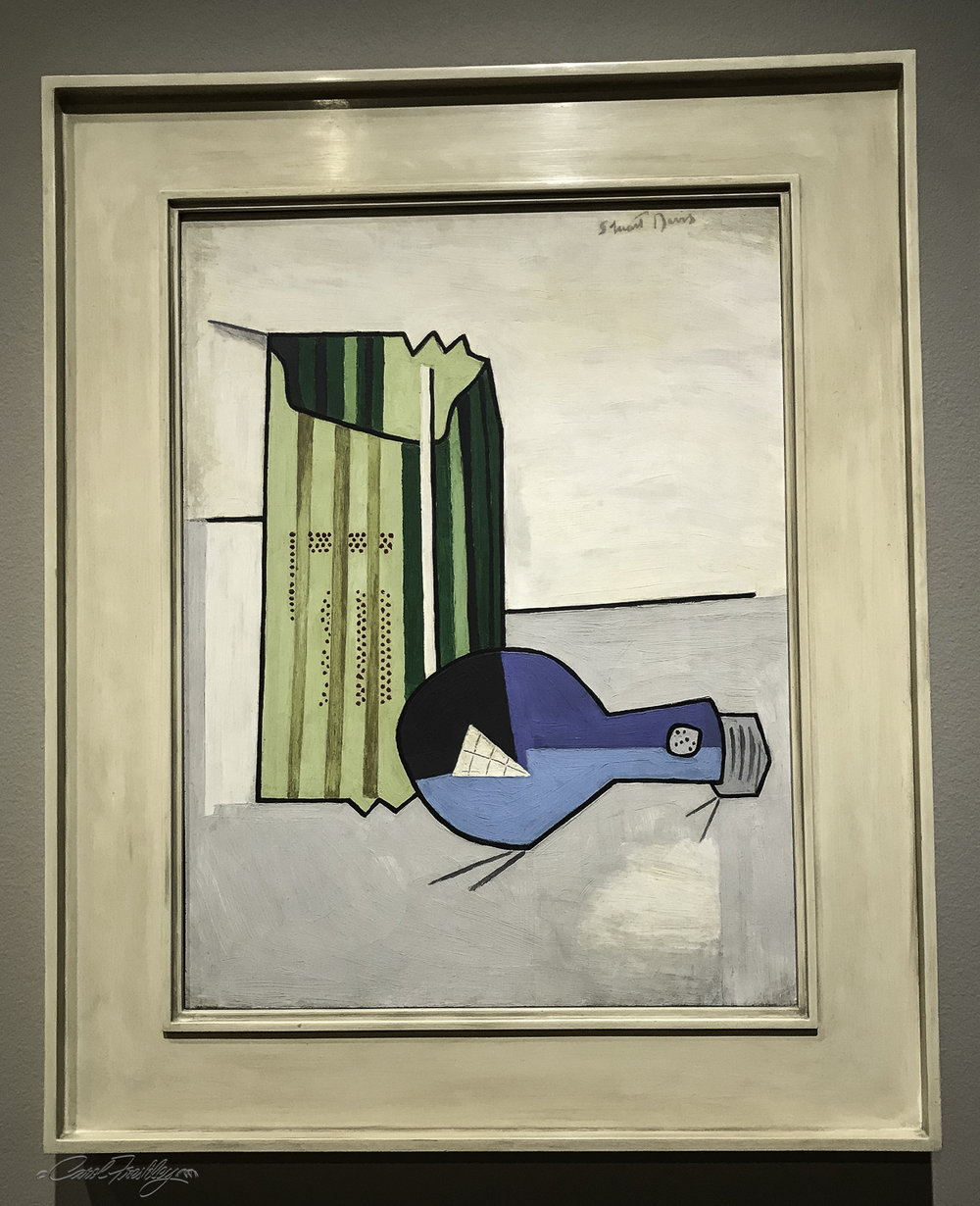 Electric Bulb , by Stuart Davis (1892-1964).  Davis was very interested in modern European art and spent decades investigating the many ways that French artists, in particular, simplified their compositions.  Here the artist used a modern item, for its time, and its protective wrapper to create a bouncy, almost cartoon-like image that is pushing the definition of abstraction.  It was noted that in 1924, the date this painting was created, 30% of American homes still did not have electricity.