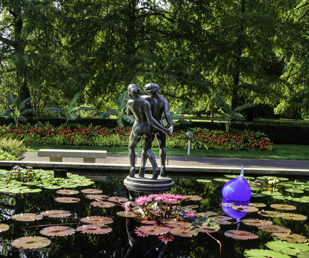 I believe most of the sculptures around the pools were created by Carl Milles (1875-1955).