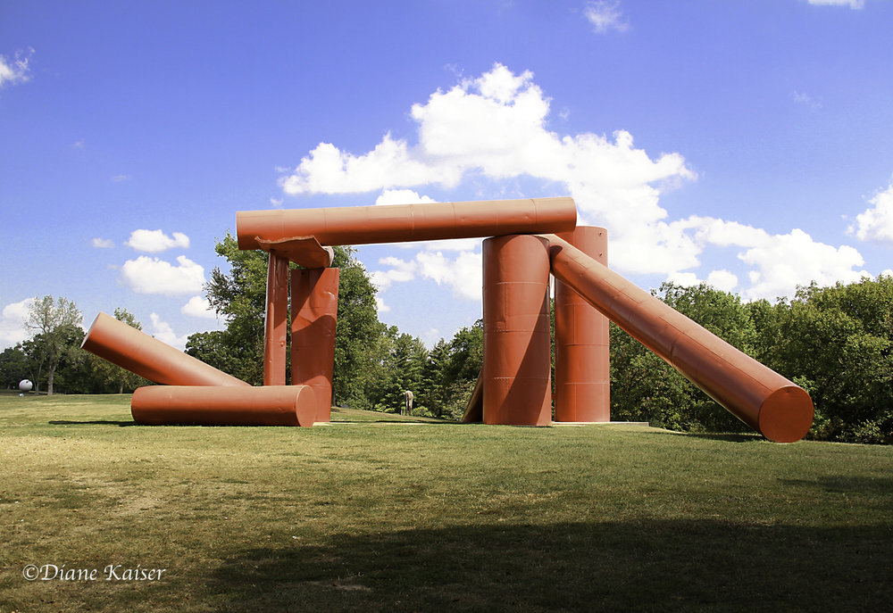 The Way , by Alexander Liberman, 1972-1980, eighteen salvaged steel oil tanks.