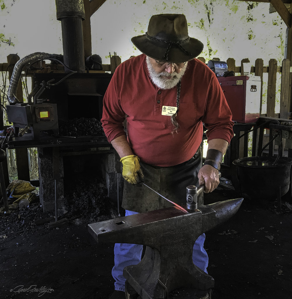 One of my favorite stops was at the blacksmiths.  This gentleman was so good at explaining everything from the history and quality of his anvil and drill press to how he looks for a certain color in the heated metal.