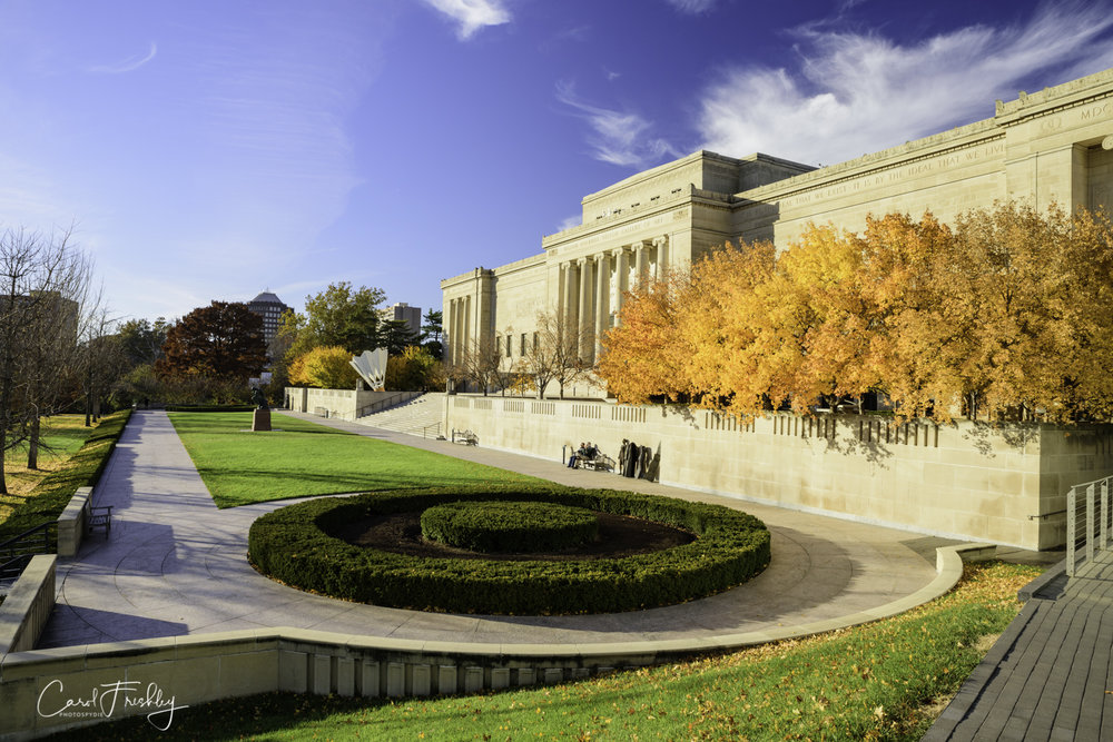 The grounds appear expansive and open.  From this one spot you can see the  Storage  sculptures (standing along the wall this side of the people sitting on the bench), the  Thinker  (in the front grassy area) and one of four  Shuttlecocks.   The fall color had almost past peak in some areas and gone in other areas.
