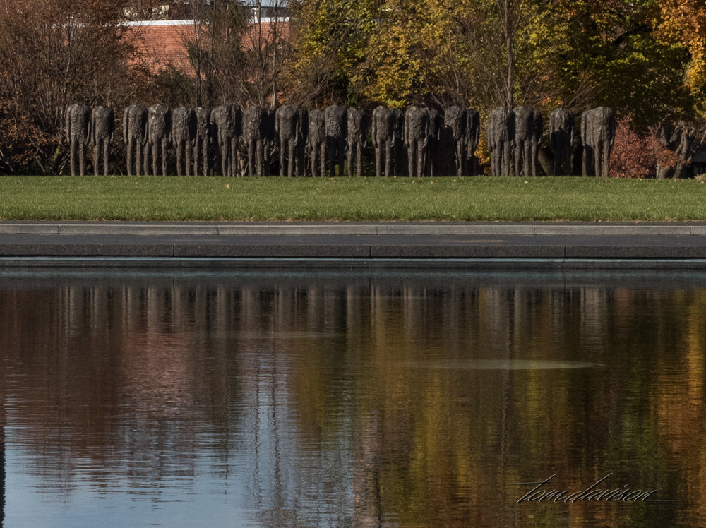 Magdalena Abakanowicz's  Standing Figures   are instantly identifiable by their stark imagery.  The haunting power of these headless, standing figures invites many interpretations and the artist welcomes this approach.  Could they be awaiting final judgement?  Do they suggest war victims?  Are they primordial beings in silent communication.?  Each figure is individually cast from a burlap-lined body mold.""