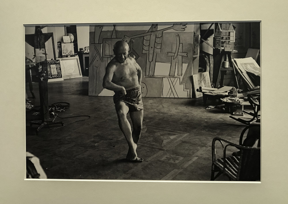 This is one of my favorite photographs in the exhibit.  After Jacqueline gave up trying to teach Picasso a ballet routine, the moment she sat down he twirls away in his own routine, stomping and whirling, a combination of square dance and dervish.  1957
