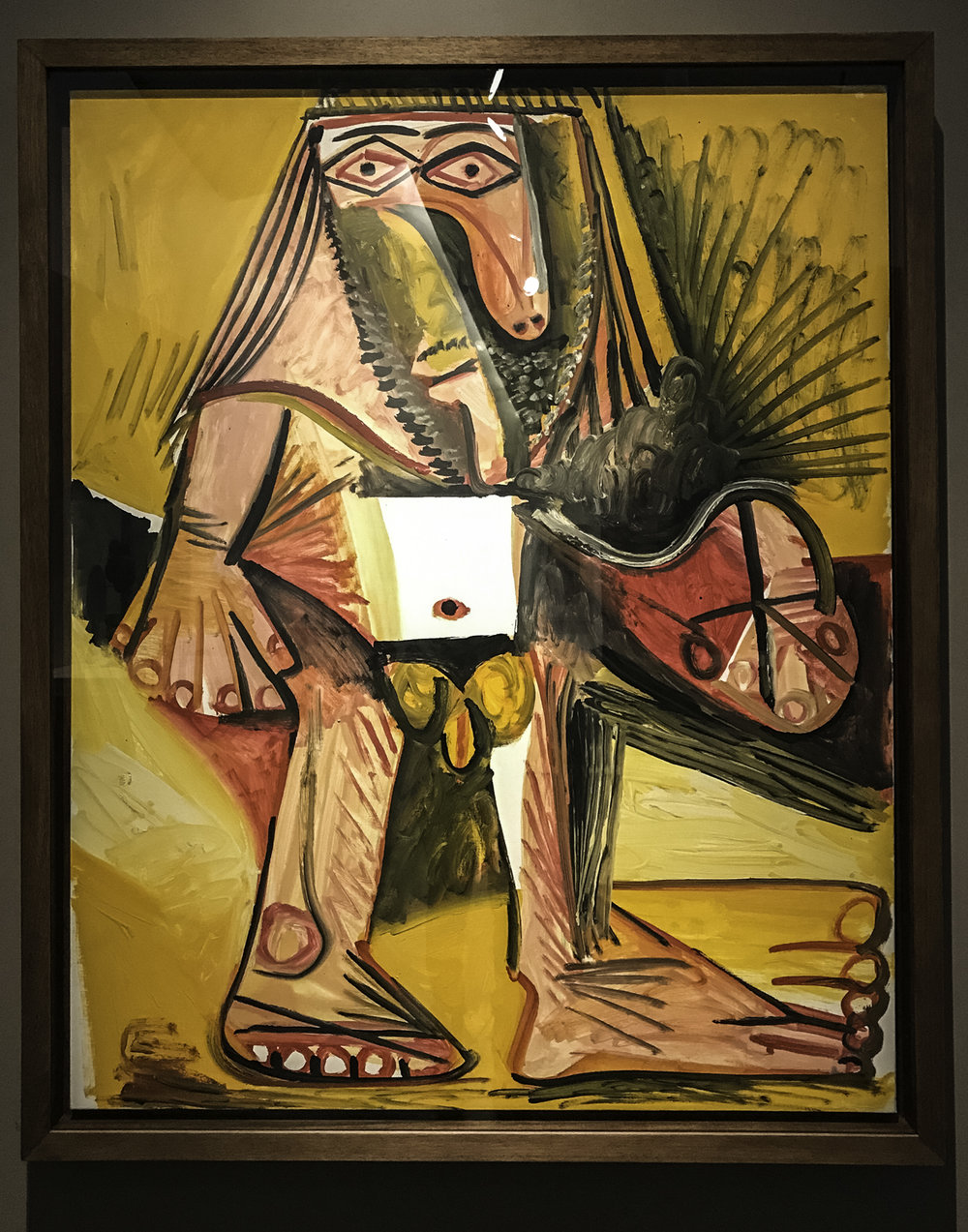 "Man,   oil on canvas, 1971. ""Picasso's erotic desires are revealed repeatedly in his later work.  This energetic depiction of a naked body can be considered a self-portrait.  Drawing on his knowledge of ancient Egyptian art, Picasso portrayed himself as a pharaoh with black-outlined eyes and rigidly posed hands and feet."""