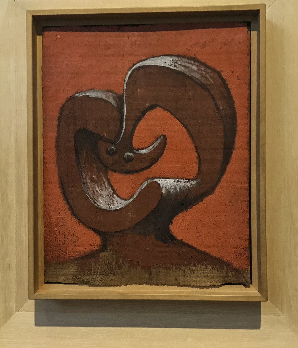 Head on Red Background,   oil on wood, 1930.