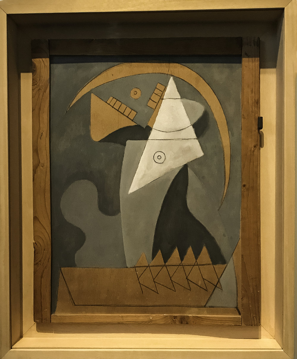 "Figure,   oil and charcoal on plywood closet door, 1930. ""Women who provoke and perplex are the subject of many of Picasso's visions around this time.  He had turned against his wife, Olga Khokhlova, while nurturing an affair with a younger woman, Marie-Thérèse Walter.  Many of his female figures become flat, geometric and puzzle pieces with no depth and an ominous air.  This is in extreme contrast to the voluptuous grace accorded to depictions of Marie-Thérèse."""