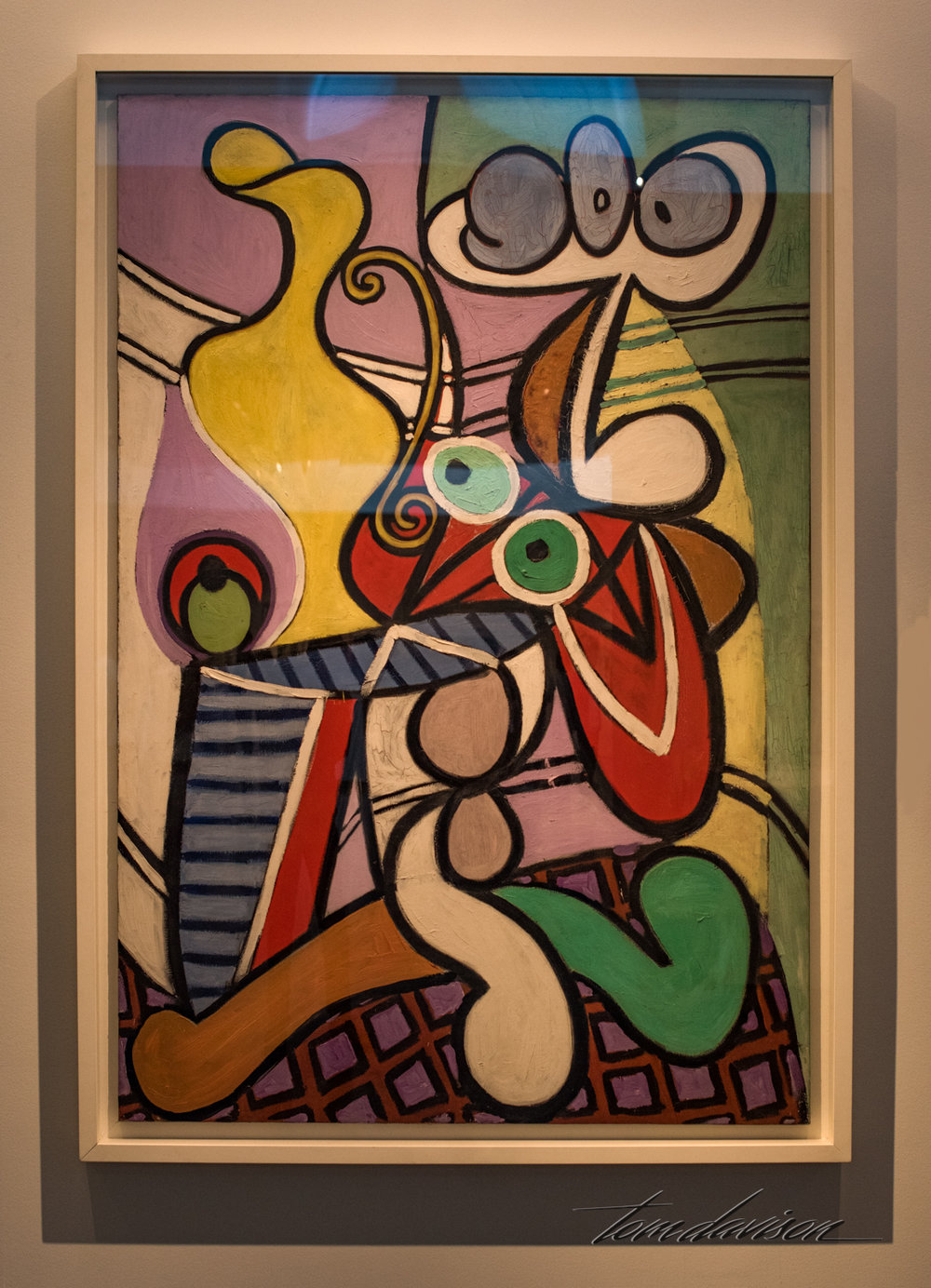 "Large Still Life on a Table,   Oil on canvas, 1931.  ""This still life is far from still.  Everything seems to be in motion - the white cup wobbles, and the table legs rush out like tentacles.  Underlying these dynamic forms and playful colors is a disguised portrait of Picasso's lover, Marie Thèrése Walter.  In his own way, Picasso subverted the still-life tradition.  Constantly alert to suggestive visual puns, he once said, ""Objects rhyme, as words do, in painting melon rhymes with mandolin."""