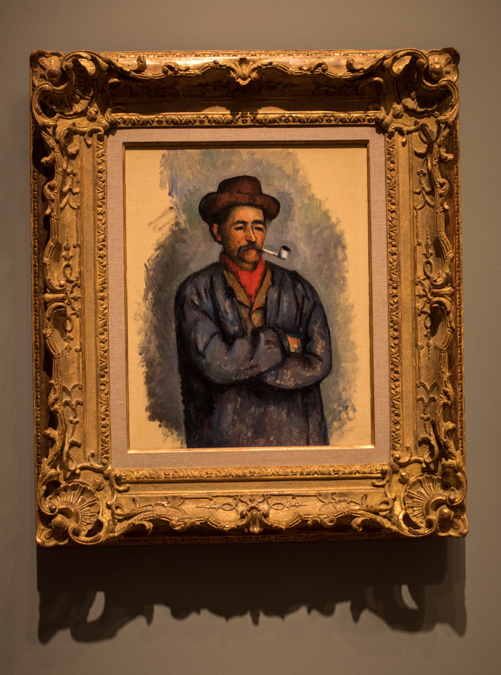 "Man with a Pipe,  1890-1892 by Paul Cézanne (1839-1906), oil on canvas.  The artist wrote' ""I love above all else the appearance of people who have grown old without breaking with old customs.""  This painting is one of a group of studies related to  The Card Players,  one of Cézanne's most important pictorial projects.  The local workers reminded him of qualities he admired - steadfast, unchanging, and monumental."