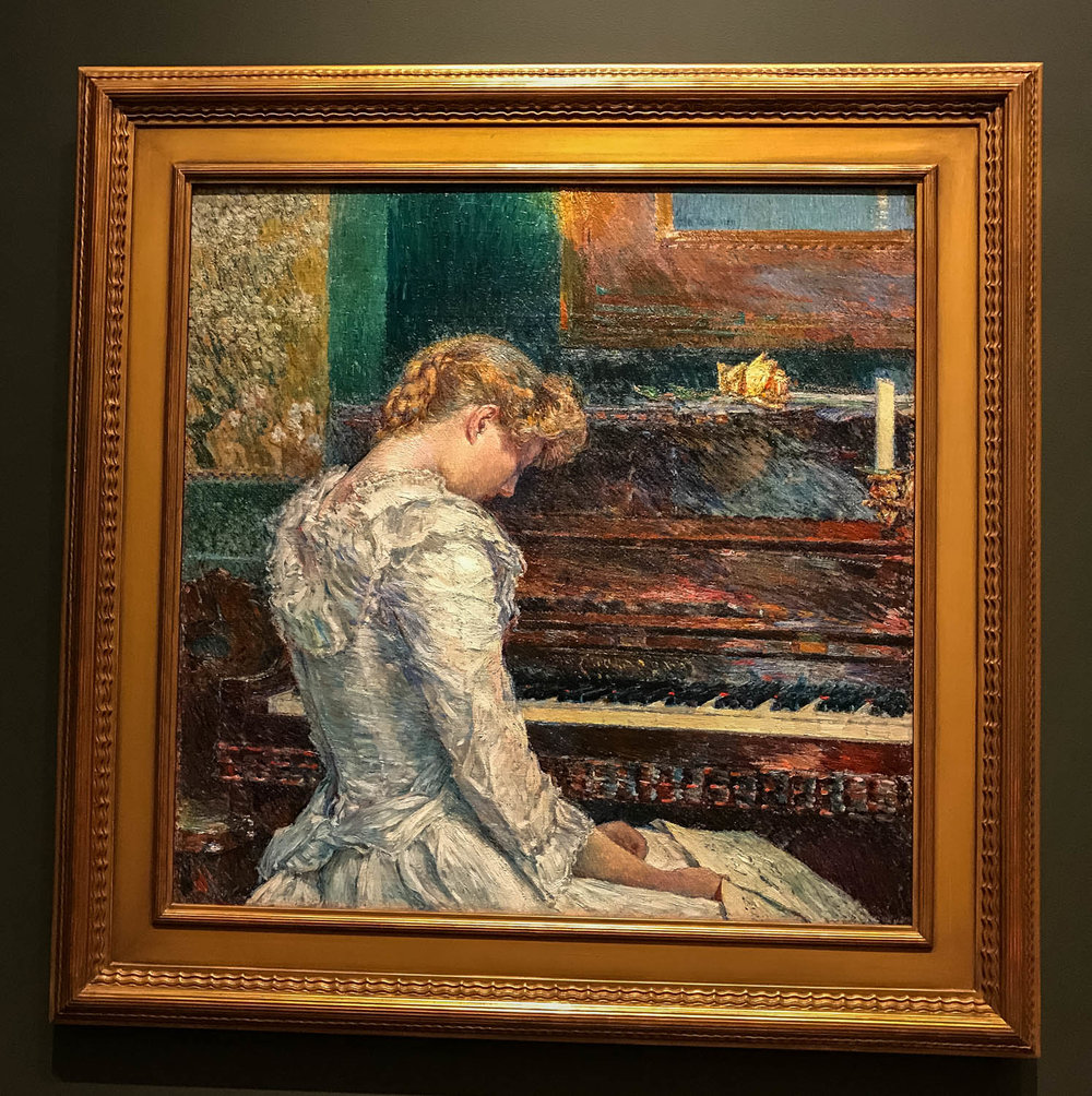 "The Sonata , 1893 by the American Childe Hassam (1859-1935), oil on canvas.  From the tag: ""Combining luminous color, staccato brushwork and academic drawing, Childe Hassam's  The Sonata  exalts sensory and aesthetic experiences.  The painting feature a pianist having just performed Beethoven's famously difficult  Sonata Appassionata,  a score for which she holds in her lap.  He slouched posture, echoed by a similarly beautiful but fragile looking yellow rose atop the piano.  A Japanese scroll showing a blossoming cherry tree also evokes the dual pleasures of sight and smell.""  The piece demonstrates the artist's endorsement of a late-19th century movement that proclaimed that art was not obliged to tell a story or to impart morals. Instead, art  could be viewed as uplifting society by celebrating beauty."