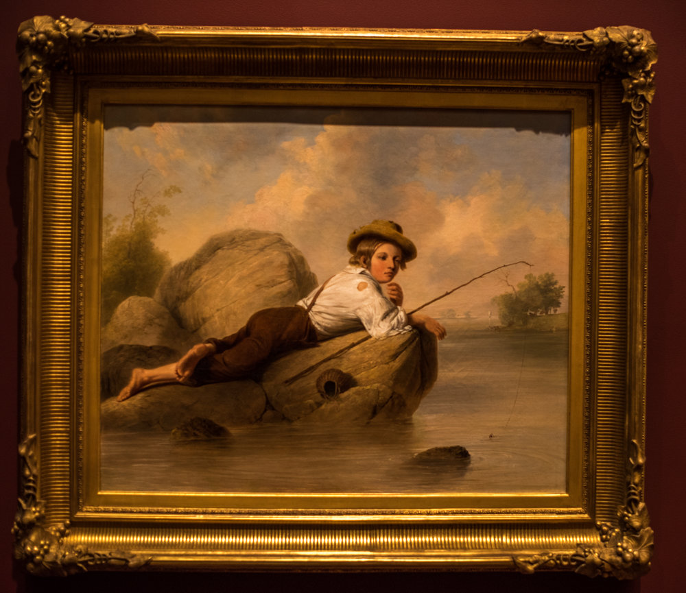 "A Lazy Fisherman , 1844 by John Gadsby Chapman, (1808-1889, oil on canvas.  From the information tag: ""A critic in 1844 described this barefoot boy in ragtag clothing as ""laziness personified"".  His complete ease is embodied in his languid pose and heavy lidded eyes and echoed in the fallen basket, lax fishing line and sluggish river.  This sentimental view, rendered with creamy, smooth brushwork, developed from John Gadsby Chapman's experience illustrating volumes of romantic verse.  His talent for drawing is revealed in the boy's hat, clothing and especially in the out-turned foot. . . . Pleasing scenes of children were especially popular in the mid-19th century as they offered musings on childhood innocence and freedom in an increasingly challenging world."""