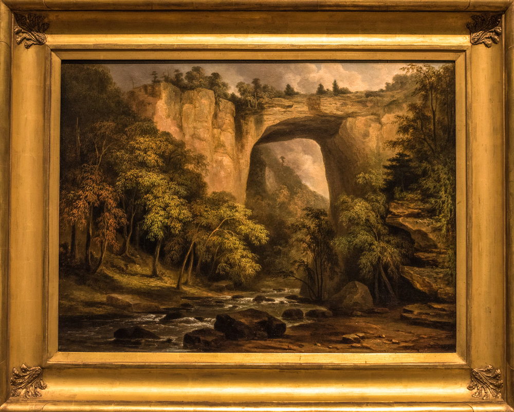 "Natural Bridge, Virginia  1835 by Jacob C. Ward (1809-1891) Oil on panel.  ""Jacob Ward painted the    Natural Bridge in Virginia so that viewers gaze at the geological marvel from below.  This low vantage point emphasizes the 200-foot height of the bridge.  Listed among the natural wonders of the world, the Natural Bridge was first owned by Thomas Jefferson, who received it from King George III in 1774.  During the early 19th century, many artists rendered the Natural Bridge because the site ranked with Niagara Falls as one of the new nation's most inspiring landmarks and tourist attractions.  Such natural monuments were thought to distinguish America from Europe."""