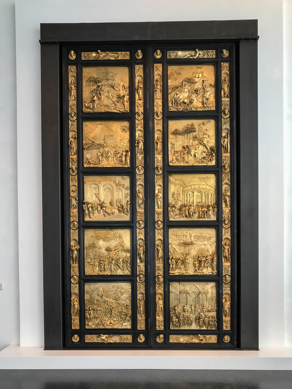 "At the end of a long walkway one will see a huge panel entitled,  Gates of Paradise .  ""They are famous because they mark major advances in rendering perspective, or receding space, and the human figure."