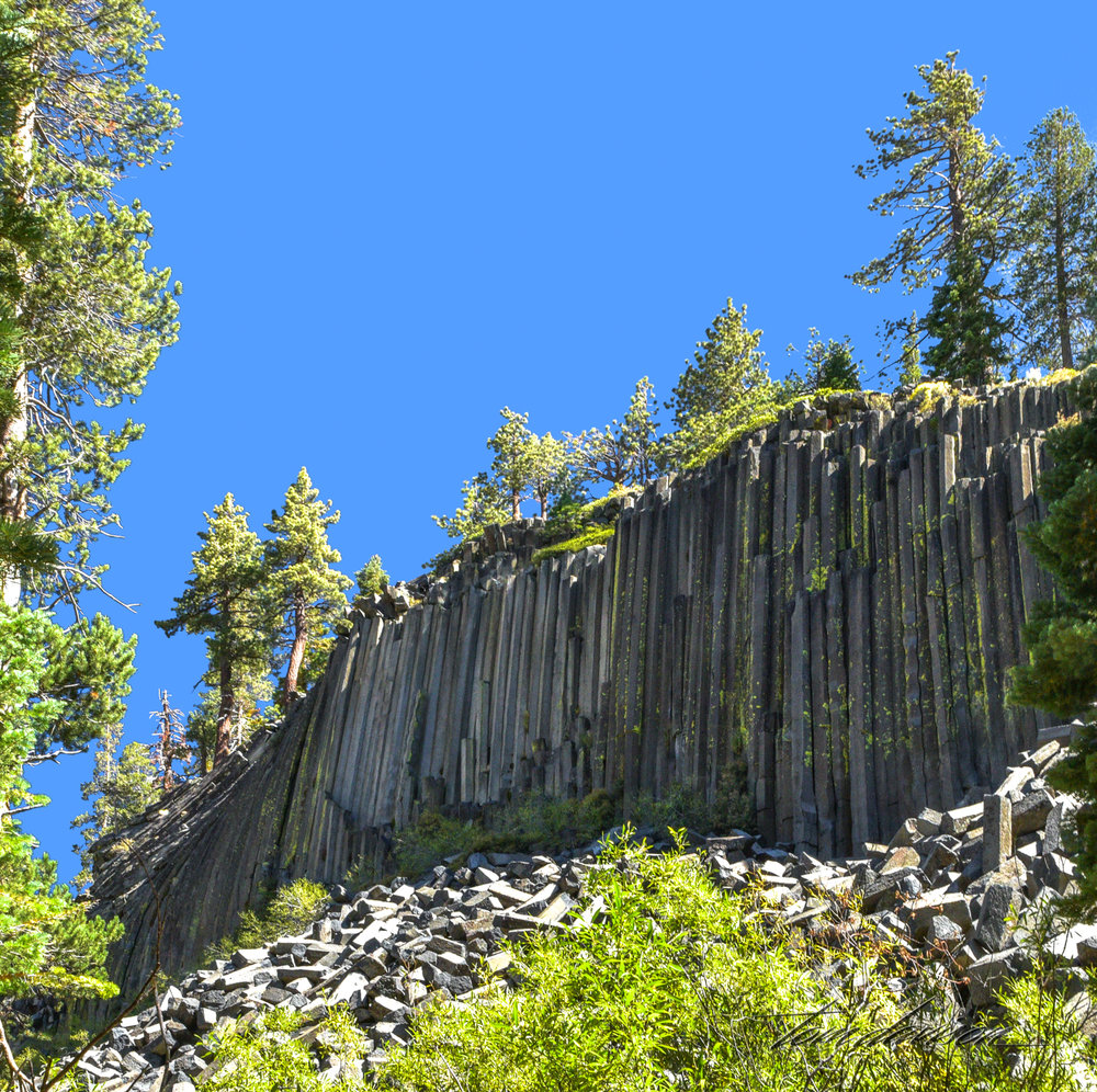 Over time, erosion and earthquakes broke off some of the columns that now lie fragmented below the postpile.