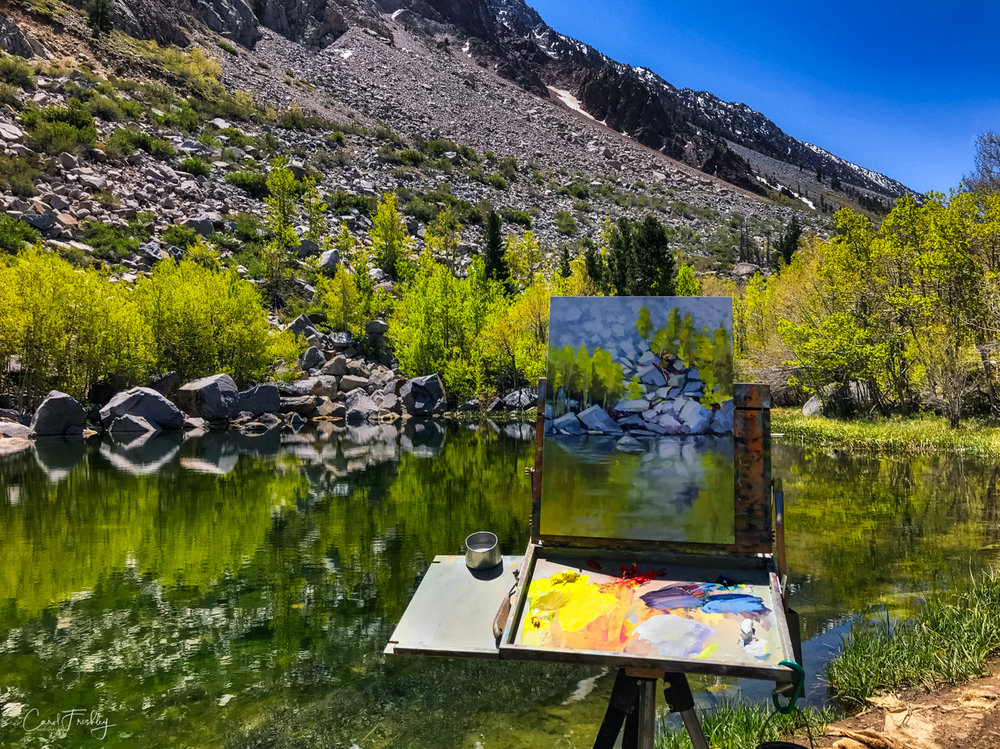 Plein air artist at pond in Aspendell