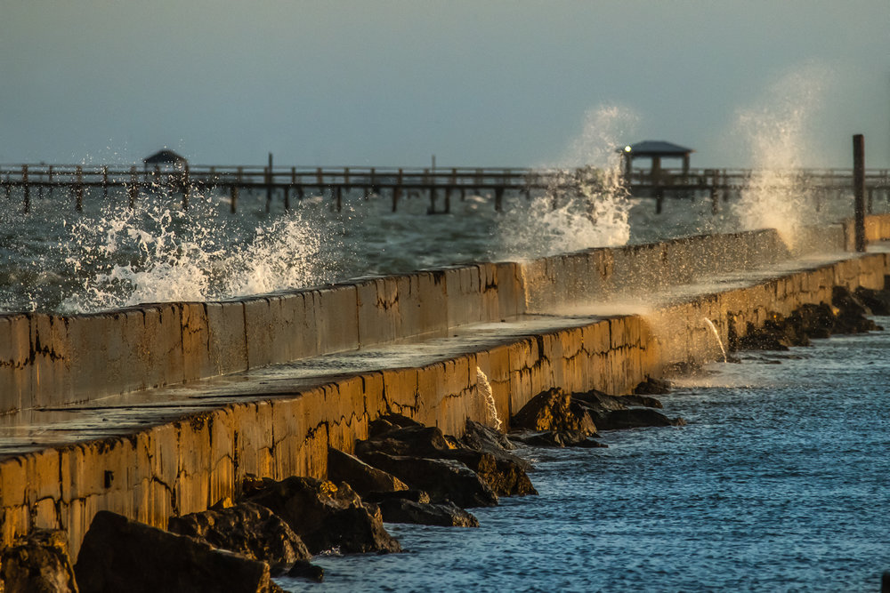 Rock and cement barriers such as his one offer protection from rough waves, leaving the marinas with smoother water.
