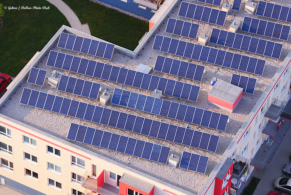 solar panels on building roof top - why don't we see more?