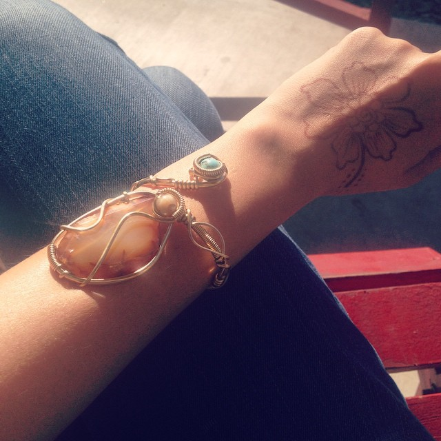 Oh y'know... just sunning ourselves in 80 degree bliss, admiring the latest piece from in-house artist ☀️💎😍#camelbackpackers #phoenix #hostel #sunshine #handmadejewelry #thegoodlife