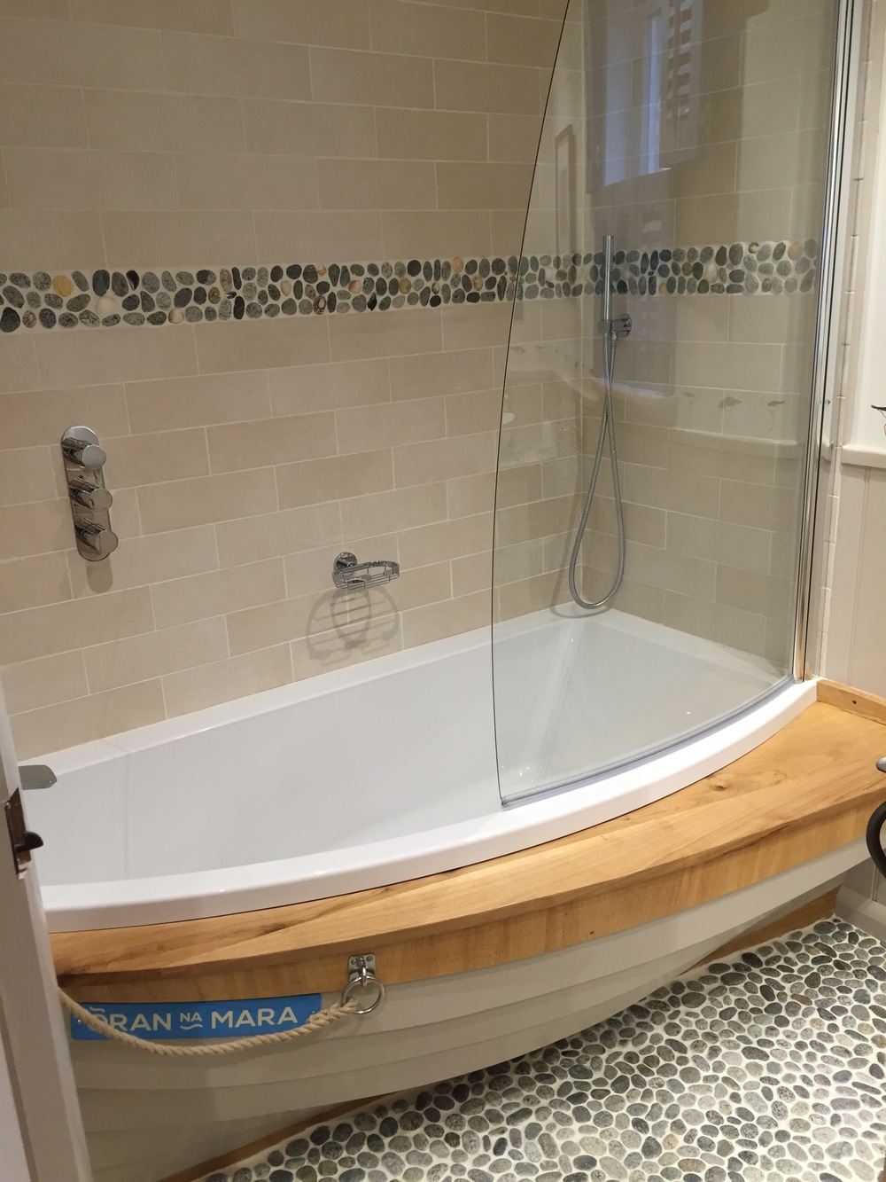 The bath surround was created by a boat builder from the islands
