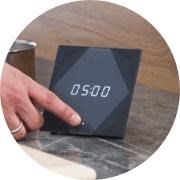 Intuitív időzítő - Ha az eszköz alját megérinted középen, be tudod állítani az időzítést.