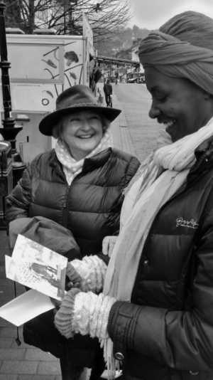 Claudia smiles at the card a stranger spontaneously gave her following another wonderful hug.