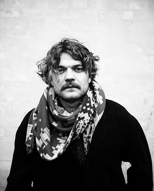 PILOU ASBÆK wearing his Emdal scarf