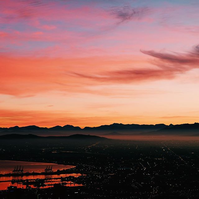 When the alarm goes off at 4AM, you grumble and think to yourself - is this even worth it? But when you get to the top of that mountain and look out and see the most beautiful ombré pink sunrise enveloping the city, you can't help but simply smile. #magic #morningslikethese