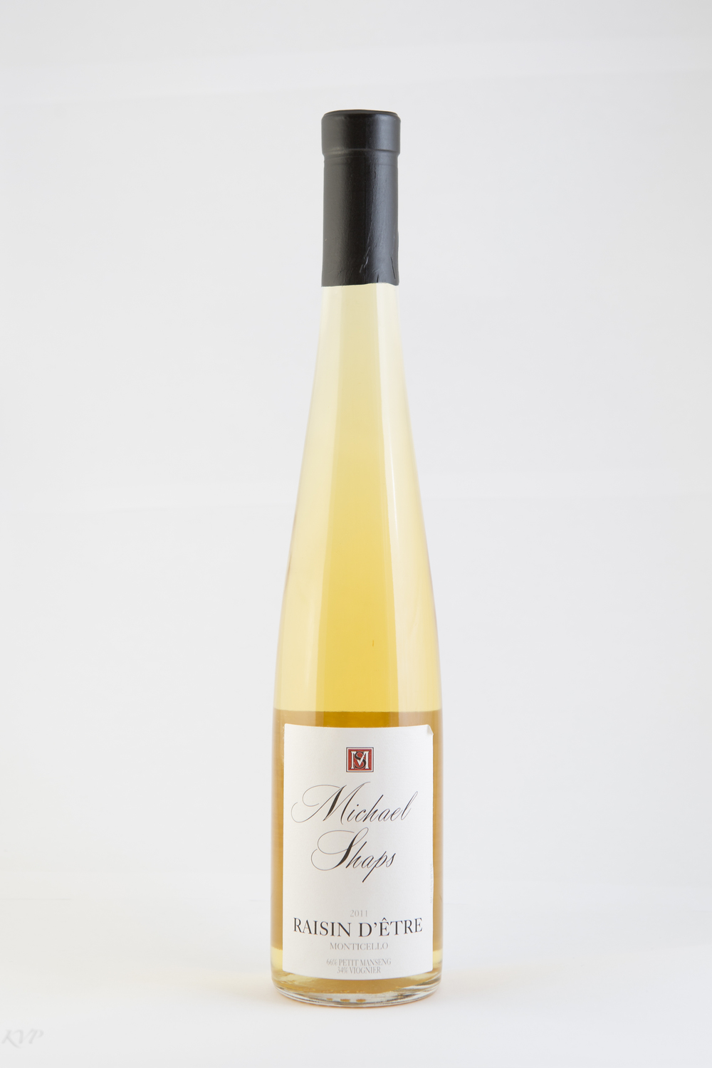 "Michael Shaps Raisin D'Être White 2012 $25 This unique wine won a Gold medal at the 2015 Governor's Cup wine competition and was also selected for the Governor's Case.  The 2012 Raisin d'Être (a play on words) is our way of replicating a traditional late harvest wine.  Similar to late harvest wines where grapes turn to raisons while still hanging on the vines, we salvaged tobacco drying barns from Southside Virginia for use in a similar drying process, but where the drying process takes place in the barns, not on the vines.  Utilizing fans and heat to dry the grapes out (thus ""raisin"" not ""raison""), we are able to create a unique dessert wine with highly concentrated fruit."