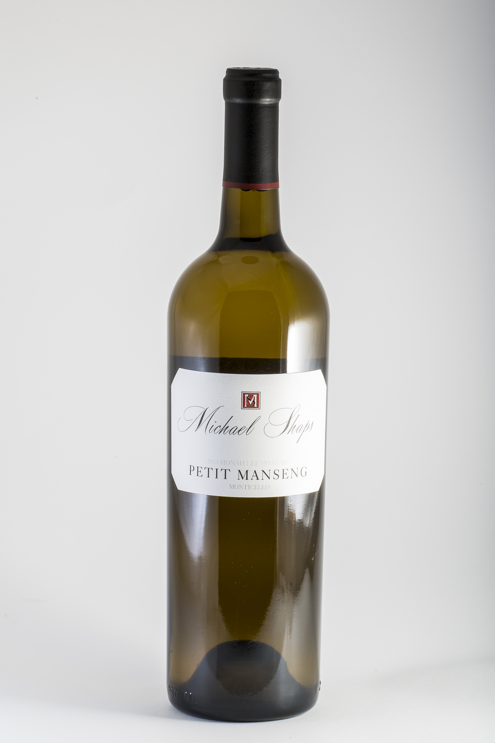 Michael Shaps Petit Manseng 2014 $30 Our Petit Manseng 2014 won a Gold medal at the 2016 Governor's Cup wine competition and was also chosen for the Governor's case. From the Honah Lee vineyard, this is fermented mostly in French oak barrels, one-third new, with a small percentage in stainless steel tank, and was bottled after six months of aging with no malolactic fermentation. It is bone dry, but brimming with the sweetness of  tropical fruit notes, and is full bodied and very concentrated. Made possible by our unique growing conditions, this style of wine is specific to Petit Manseng grown in central Virginia.