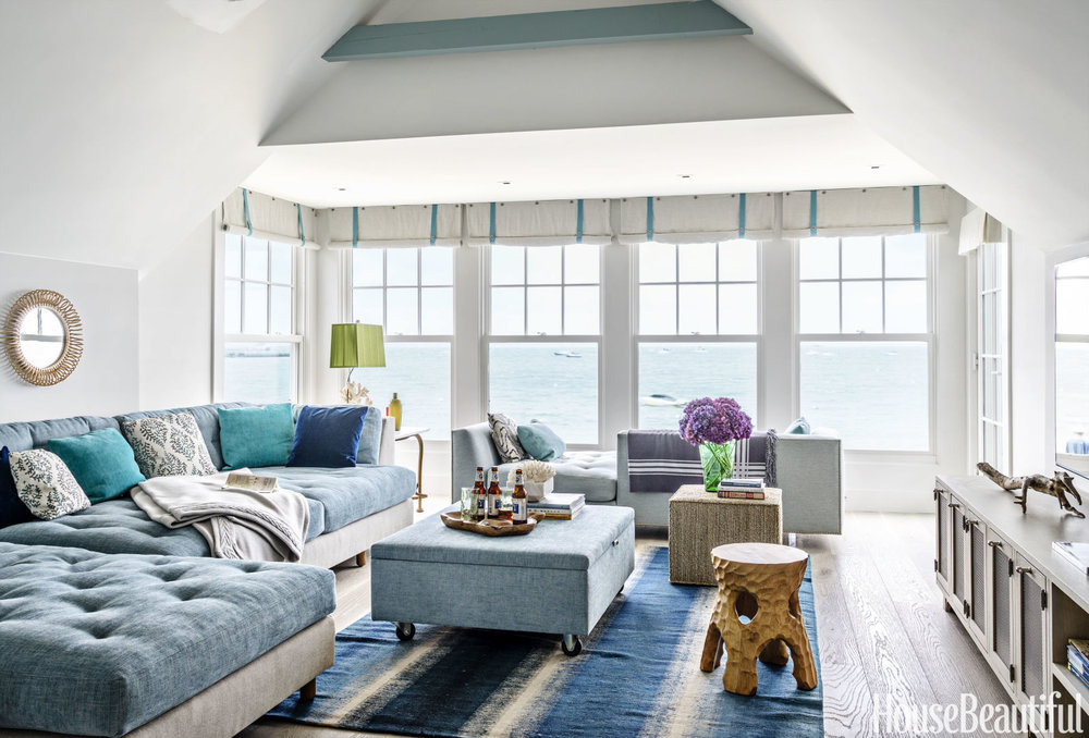 The sitting room upstairs looks so relaxing in this muted blue palette.  I love the old fashioned roll up window treatments.