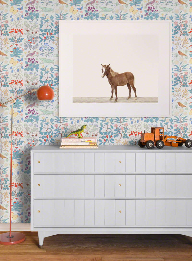 Last, but certainly not least, this pony is fun and quirky on this botanical wallpaper alongside a bold modern floor lamp.