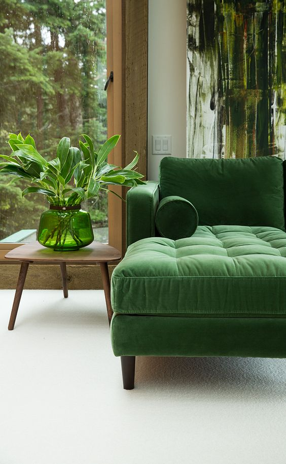 I love this mid-century inspired sofa in an emerald green velvet.  The artwork, plant and walnut side table make this room so moody to me (in a good way!) Image via Article.