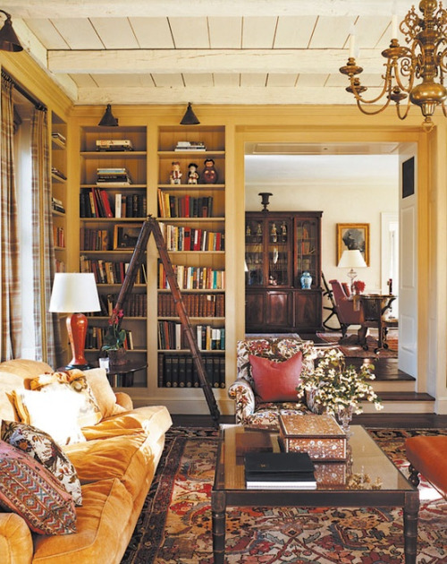 I would love to curl up with a good book on a snowy day in this room.  It's so warm and cozy and shows how this color can be used in a more traditional way.   Image via  The Fuller View