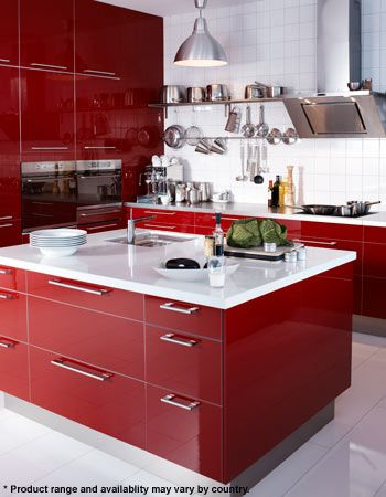 My brother actually had these glossy, red Ikea cabinets in his old apartment.  He paired them with a butcher block countertop and it was really a beautiful, warm, and modern space.  Image via  Ikea