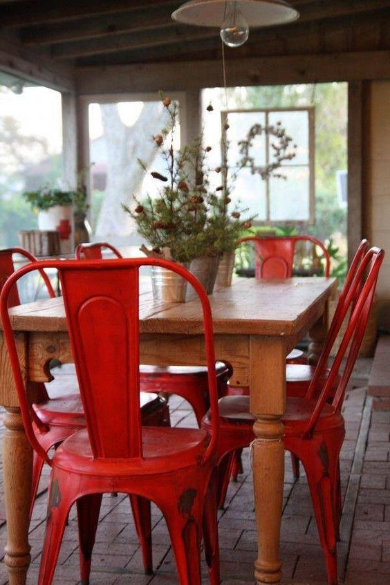 I love adding a pop of red in a dining space with chairs.  These marais chairs paired with this wooden table gives off a Parisian country vibe.  Image via  Tumblr.