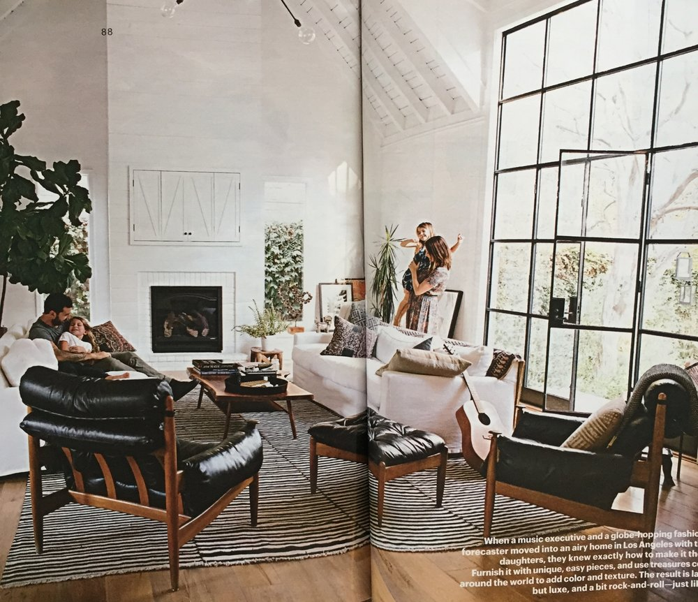 "This is the photo in the opening spread.  The vintage leather chairs bring that edginess to the room while the sofas and pillows are more bohemian.  I love the rug too!   Compare this to the photo in  Amber's portfolio here  and you'll see how different a room can feel just by showing it more ""lived in""."