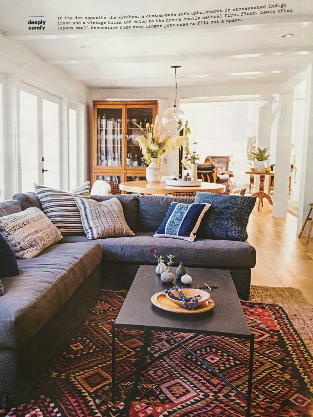I love the casualness of this custom sofa in a linen that looks like a denim.  A layered rug look is always a great way to add texture to a room.