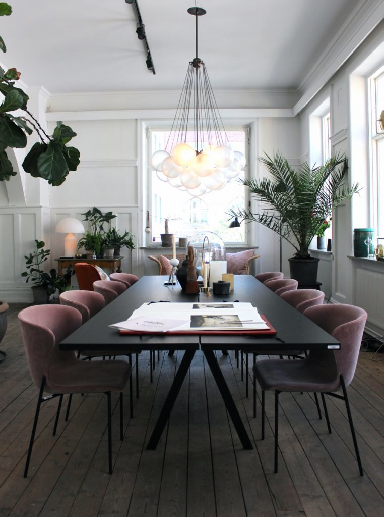 A more modern use of the color lavender, this time in these sleek upholstered dining chairs.  I love that this complementary color scheme only uses plants to incorporate the green opposite purple on the color wheel.  Image via Remodelista