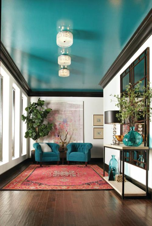 The teal on the celling balances the teal on the two chairs - very eye catching!  Image via  Real Simple