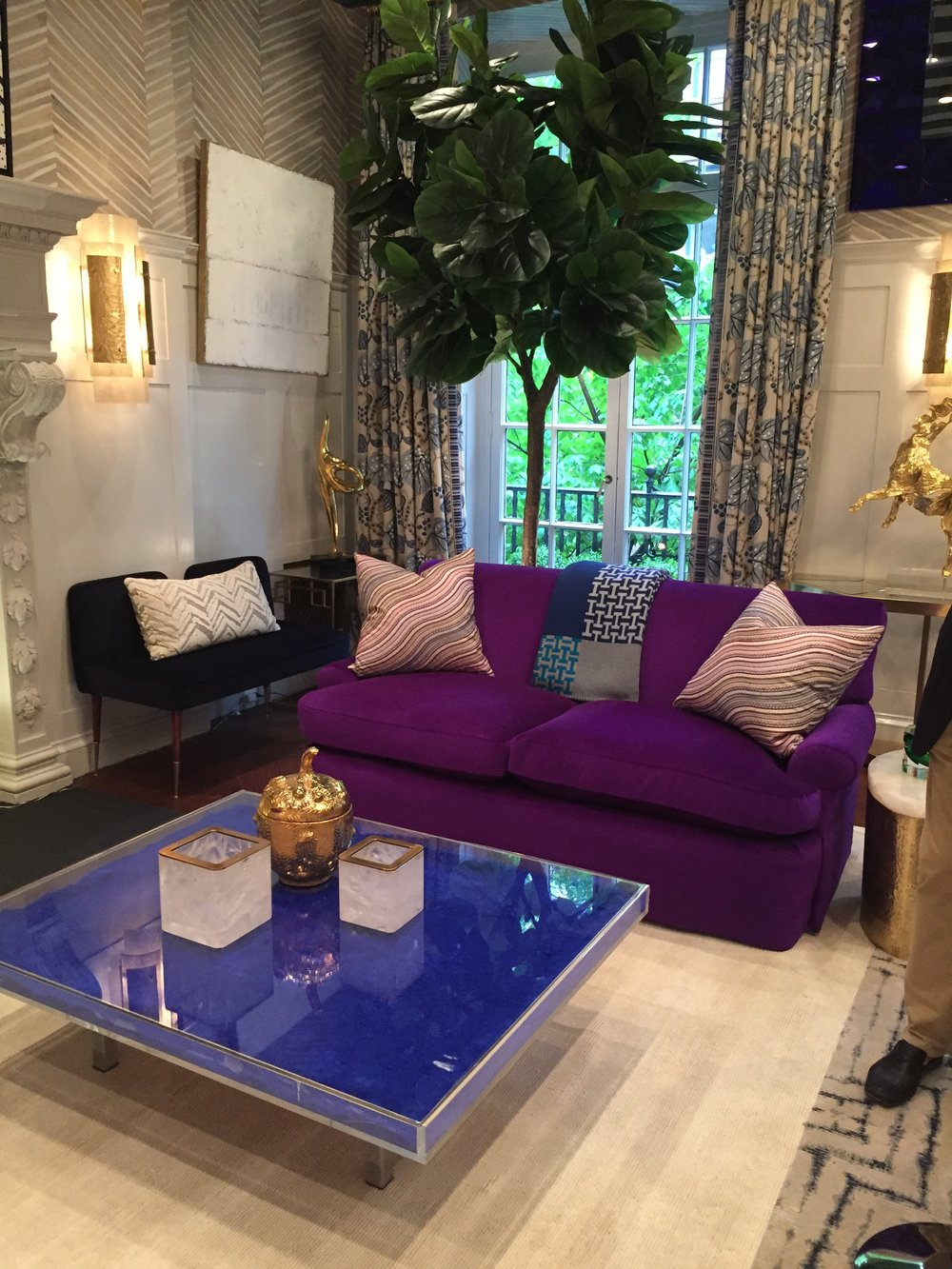I neglected to snap a pic of the artwork in this room by  Kirsten Kelli  (which had a lot of cool pop art) because I was mesmerized by this purple, velvet sofa.  Such a great color! This was probably my second favorite room behind Robert Stilin's.  Super bold and interesting.