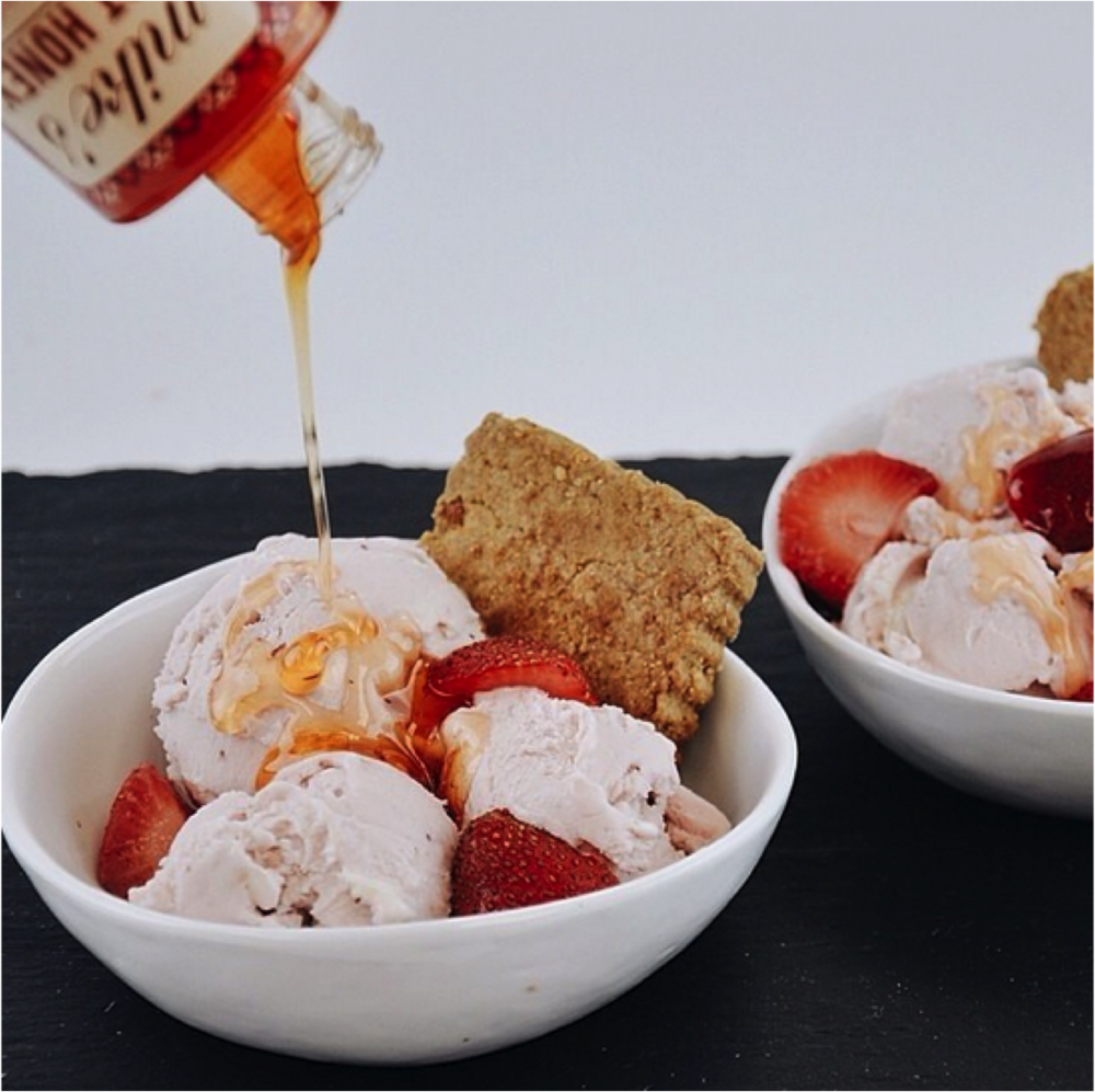 Image courtesy of @stevesicecream Steve's Ice Cream's Strawberry Ricotta Sundae with fresh strawberries, Salvatore Brooklyn's Ricotta and Mike's Hot Honey.